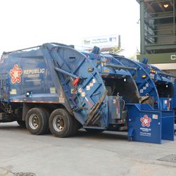 5:23 p.m. Garbage trucks being loaded outside Gate A -