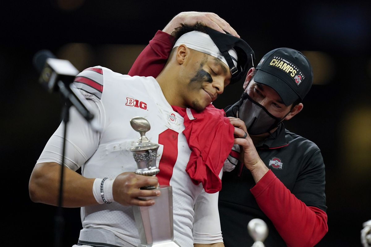 Ohio State coach Ryan Day hugs quarterback Justin Fields after their win against Clemson in the Sugar Bowl.