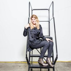 """<p><b>Megan O'Brien, eBay's fashion editor,</b> is wearing a Sandro tunic, Helmet Lang wax-coated jeans and Rick Owens metallic wedge booties. </p><p>  <b>What is your work style?</b></p><p> """"My style transcends occasions (even work!) unless I'm going"""