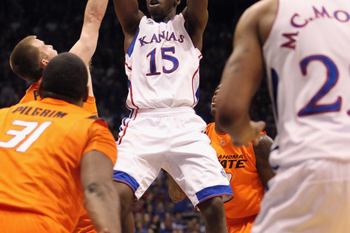 LAWRENCE KS - FEBRUARY 21:  Elijah Johnson #15 of the Kansas Jayhawks grabs a rebound during the game against the Oklahoma State Cowboys on February 21 2011 at Allen Fieldhouse in Lawrence Kansas.  (Photo by Jamie Squire/Getty Images)