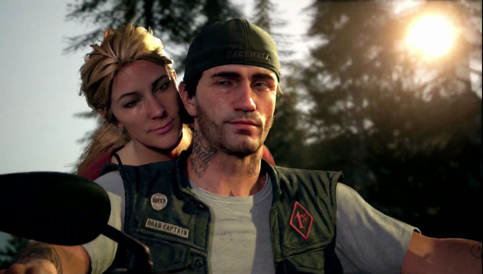 Days Gone - close-up of biker on motorcycle with woman behind him