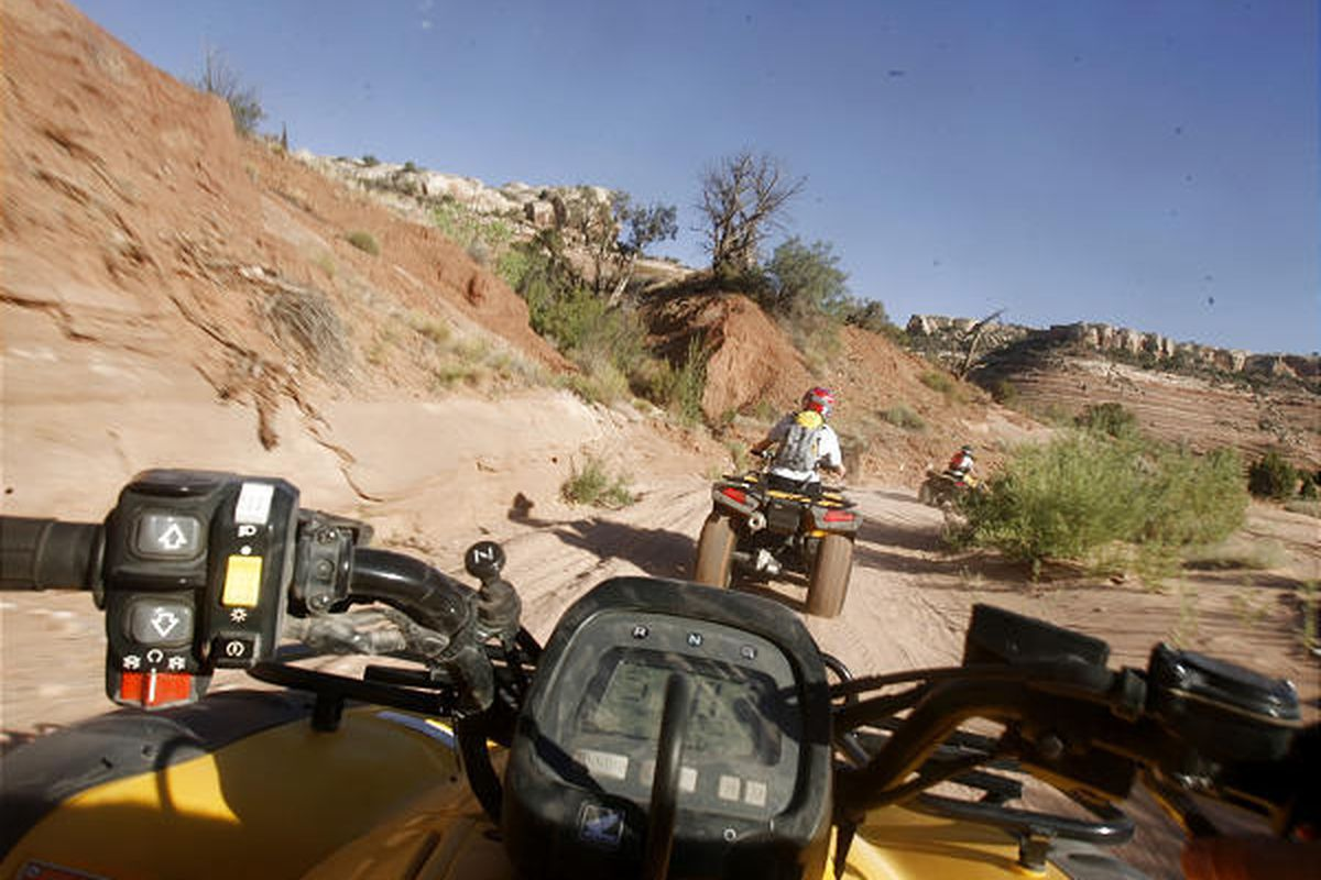 Off-road-vehicle enthusiasts ride through a recreation area near Moab, a popular destination for ORV users.