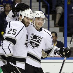 Los Angeles Kings' Slava Voynov, of Russia, is congratulated by Dustin Penner, left, after scoring against the St. Louis Blues during the first period of Game 1 in a second-round NHL Stanley Cup hockey playoff series, Saturday, April 28, 2012, in St. Louis.