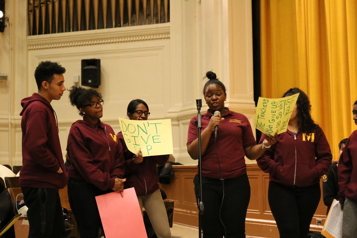 Students from Monroe Academy for Visual Arts and Design protest the planned closure of their school at a recent public hearing.