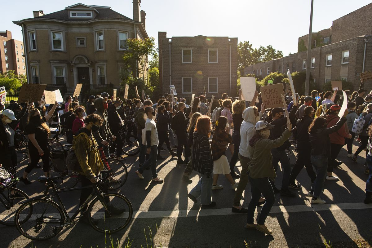 Hundreds of protesters march through Chicago's Washington Park neighborhood Friday demanding the defunding of the Chicago Police Department and the creation of the Civilian Police Accountability Council.