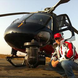 """Blair Treu is the writer and director of the LDS Church's new documentary, """"Meet the Mormons."""" He is pictured in front of film equipment attached to the front of a helicopter."""