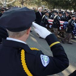 Officers salute during the funeral procession for Ogden police officer Jared Francom in Ogden Wednesday, Jan. 11, 2012. Francom, a seven-year veteran of the force, was killed in the line of duty on Jan. 4, while serving a warrant. Five other law enforcement agents were wounded on the scene.