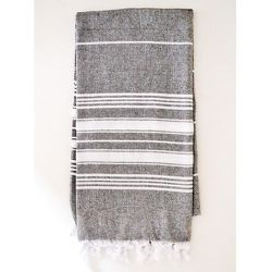 """""""When it's hot and humid, it's best to swap out for something summer-friendly (and super soft!), like a Turkish towel.""""  <br> <i><a href=""""http://www.popcircumstanceshop.com/shop/turkish-towel-in-gray-white-stripe"""">Handmade Turkish towel, $45, Pop & Circ"""