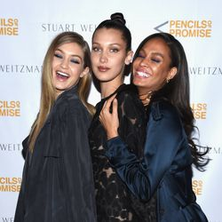 Two Hadids (Gigi and Bella) and Joan Smalls pose for a photo.
