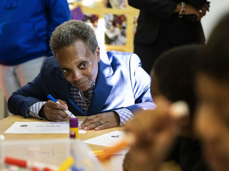 Chicago Mayor Lori Lightfoot visits with Chicago Public Schools students at the McCormick YMCA Thursday Oct. 17, 2019. Chicago teachers went on strike Thursday after failing to reach a contract deal with the nation's third-largest school district.