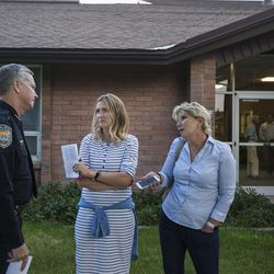 Sandy Police Chief Kevin Thacker talks with Mandy Moore and Suzanne Boyer outside an LDS meetinghouse in Sandy  on Thursday, June 8, 2017, after an interfaith gathering to comfort the community following Tuesday's deadly shooting.