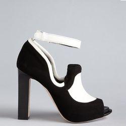 "<b>Rachel Roy</b> Fabiola Oxford Pumps in black/white, <a href=""http://www1.bloomingdales.com/shop/product/rachel-roy-oxford-pumps-fabiola-high-heel?ID=629575&PseudoCat=se-xx-xx-xx.esn_results"">$195</a> at Bloomingdale's"
