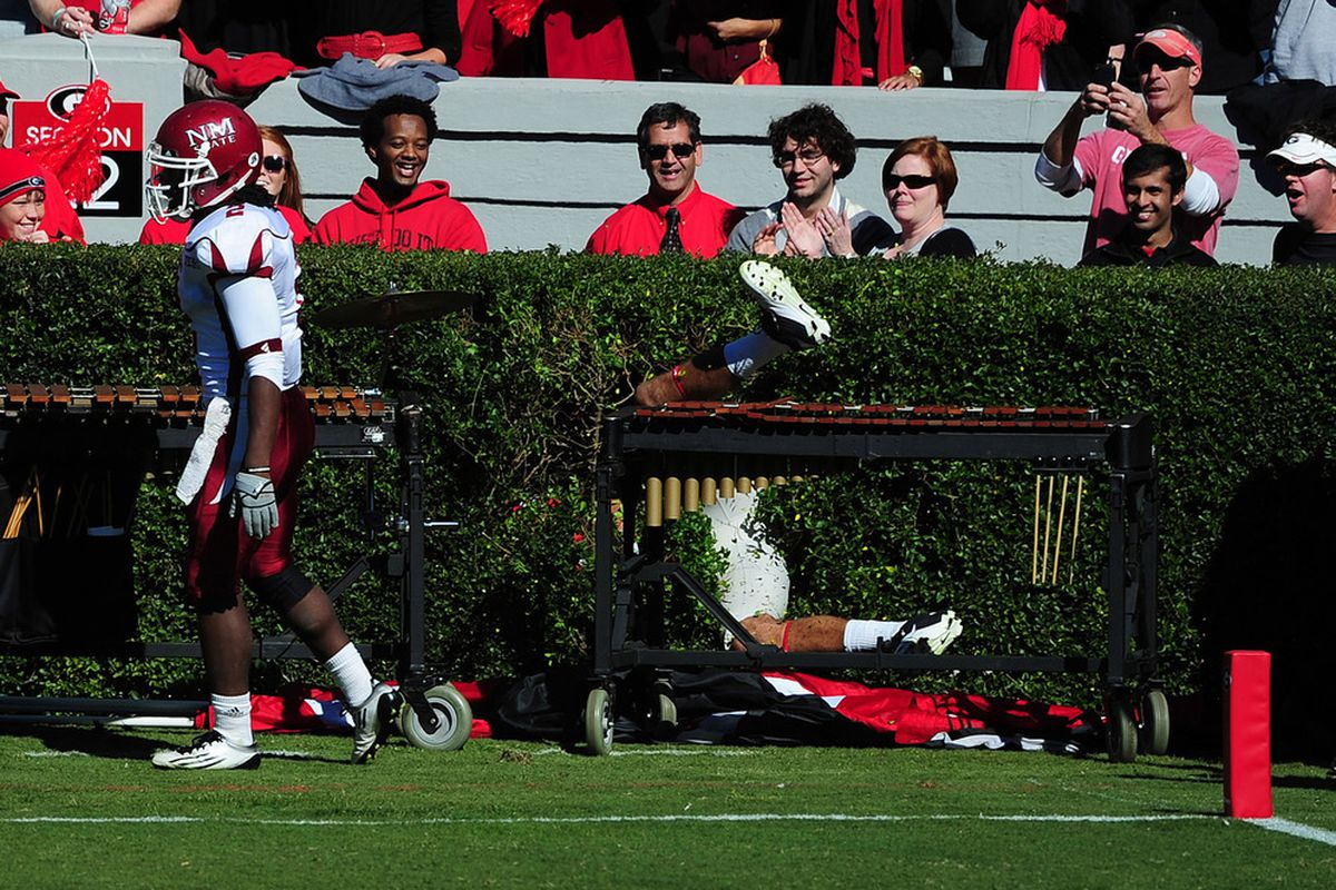 ATHENS, GA - NOVEMBER 5: Aron White #81 of the Georgia Bulldogs gets stuck in the hedges after scoring a touchdown against the New Mexico State Aggies at Sanford Stadium on November 5, 2011 in Athens, Georgia. Photo by Scott Cunningham/Getty Images)