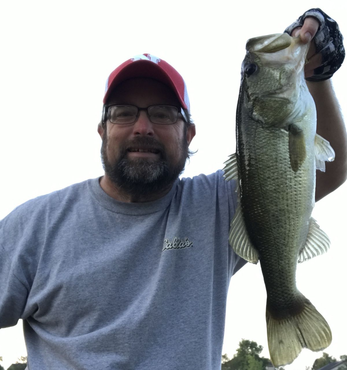 """Ken """"Husker"""" O'Malley with a fall largemouth bass. Provided photo"""