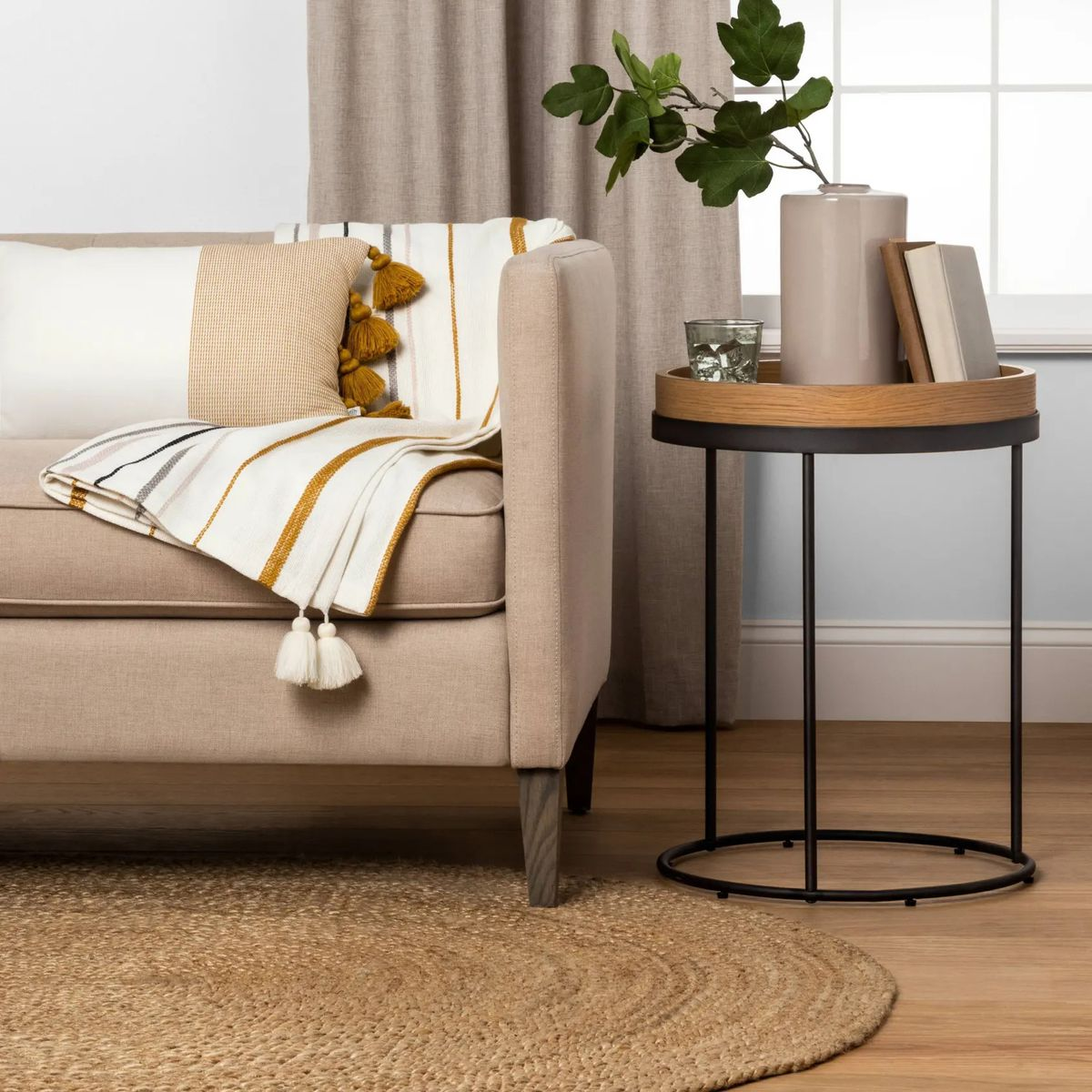 Timber and metal side table next to sofa.