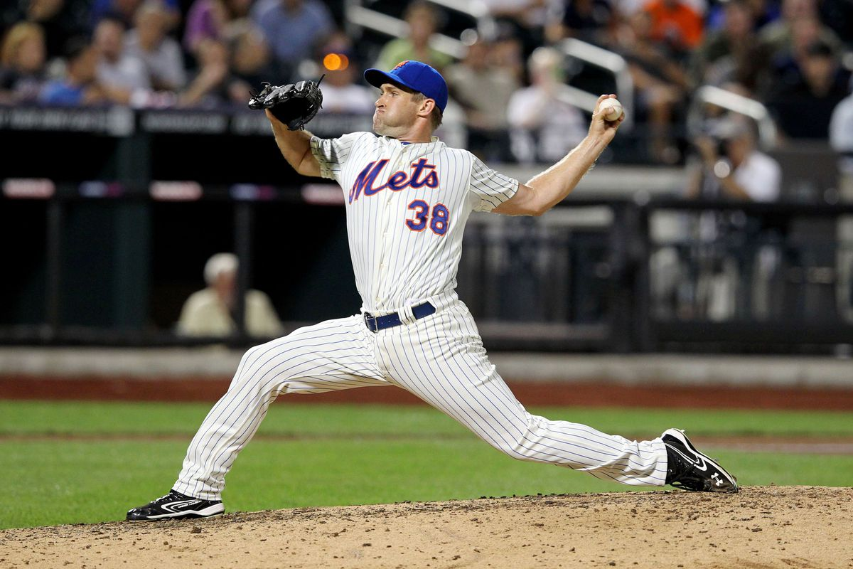 August 8, 2012; New York, NY, USA; New York Mets pitcher Garrett Olson (38) throws a pitch during the eighth inning of a game against the Miami Marlins at Citi Field. Mandatory Credit: Brad Penner-US PRESSWIRE