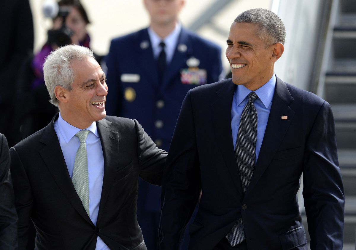 Then-President Barack Obama (right) talks with Chicago Mayor Rahm Emanuel after walking off Air Force One at O'Hare International Airport in 2016. Emanuel worked in the Obama White House during the battle over the Affordable Care Act.