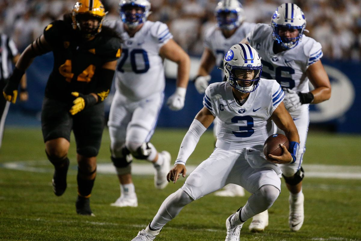 Brigham Young Cougars quarterback Jaren Hall (3) runs with the ball during a game against Arizona State.