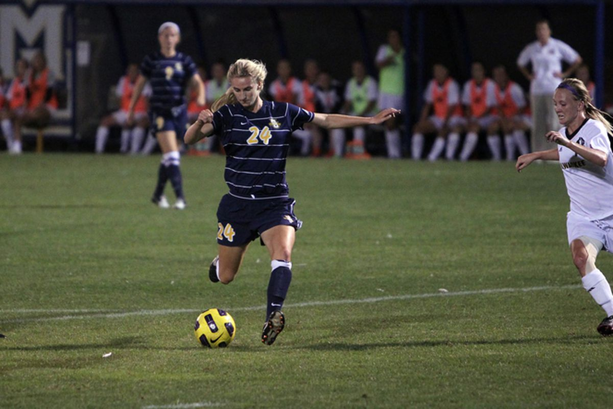 Minutes after getting dragged down as she approached the box, Mary Luba scored the winning goal in Marquette semi-final match.