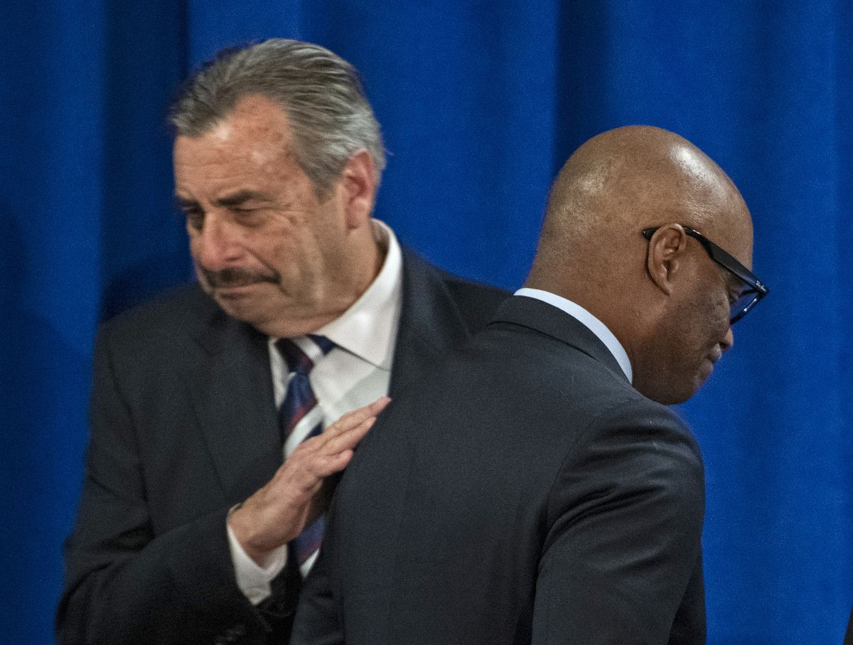 Interim Chicago Police Department Supt. Charlie Beck (left) gives his apparent successor, David Brown, a pat on the back at a news conference at which Mayor Lori Lightfoot announced she was nominating Brown to take over the top job at CPD.