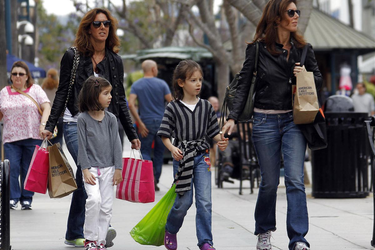 In this April 24, 2012, file photo, women and girls carry purchases on the Third Street Promenade in Santa Monica, Calif. The Commerce Department said Friday, April 27, 2012, that the economy expanded at an annual rate of 2.2 percent in the January-March