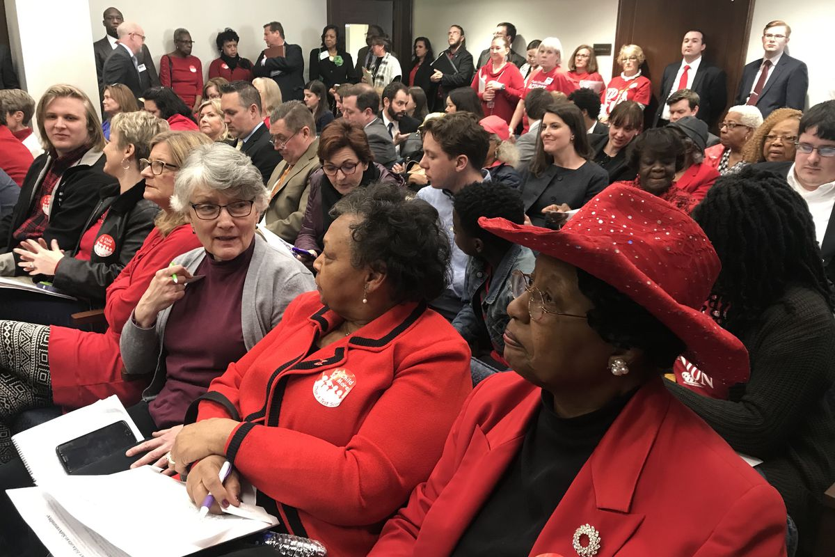 Educators wearing red pack the committee room where lawmakers considered legislation Tuesday that would create an education savings account program in Tennessee.