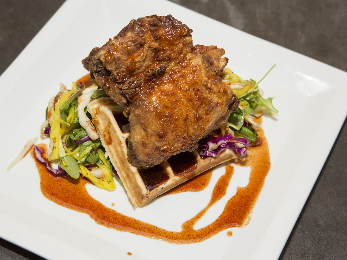 A plate of hot chicken and waffles.