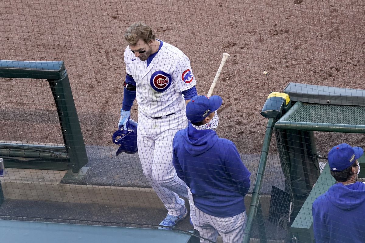 Ian Happ heads off the field after the Cubs' 2-0 loss to the Miami Marlins in Game 2 of a National League wild-card playoff series.
