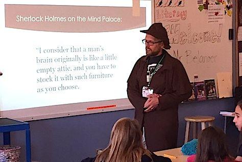 Teacher Derrick Belanger dresses as Sherlock Holmes for an author talk.