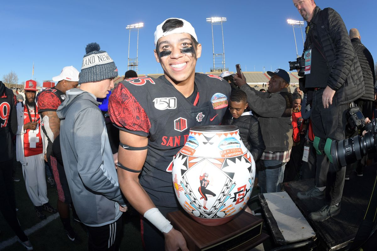 San Diego State Aztecs wide receiver Jesse Matthews holds the winner's trophy after he New Mexico Bowl against the Central Michigan Chippewas at Dreamstyle Stadium. San Diego State defeated Central Michigan 48-11.