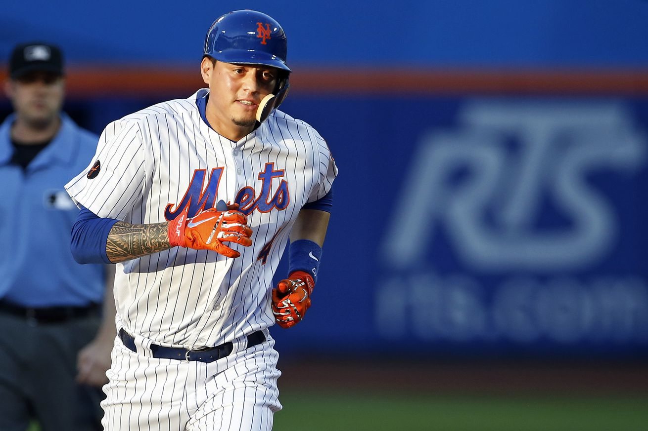 Wilmer Flores won it with a homer in the 10th inning