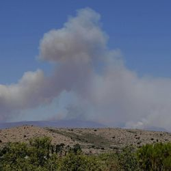 A wildfireburns near Mayer, Ariz, Wednesday, June 28, 2017, as seen from Spring Valley, Ariz. The fire about 100 miles north of Phoenix has forced the evacuation of Mayer and parts of Dewey-Humboldt along with several other communities. Some areas and subdivisions are under pre-evacuation notices.