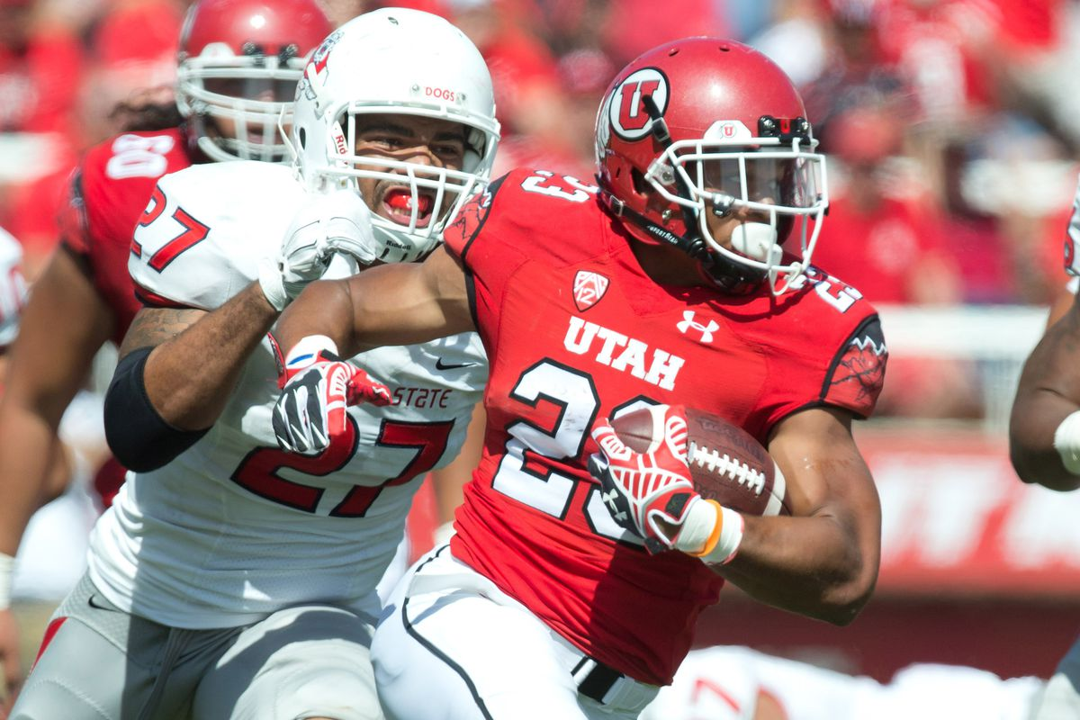 Utah running back Devontae Booker (23) and his running mate Bubba Poole will need to be productive to really put pressure on the Michigan press-man defense.