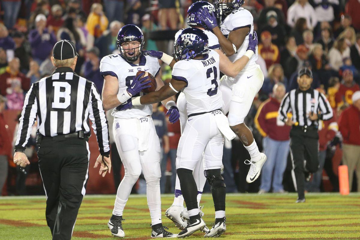 TCU tight end, Charlie Reid, and his teammates celebrate after he catches a touchdown against Iowa State