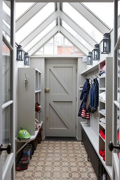 Mudroom With Wall Sconces