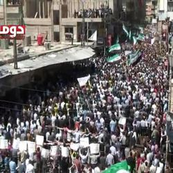 This image made from amateur video and released by Douma Revolution in Syria Friday, April 13, 2012 purports to show a large anti-government demonstration in Douma, Syria.