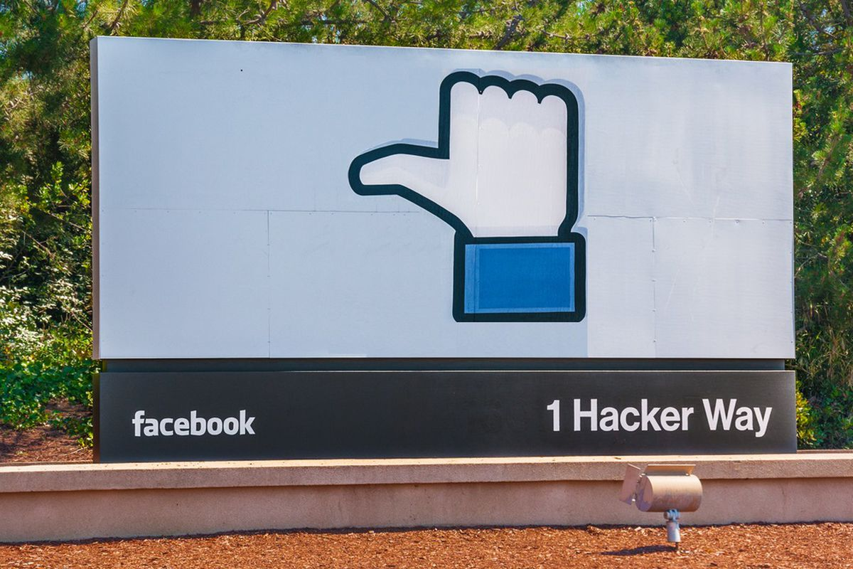 """Facebook's thumbs-up """"Like"""" logo on the company's headquarters sign, modified so that the thumb is pointing to the side, like the hand of a hitchhiker"""