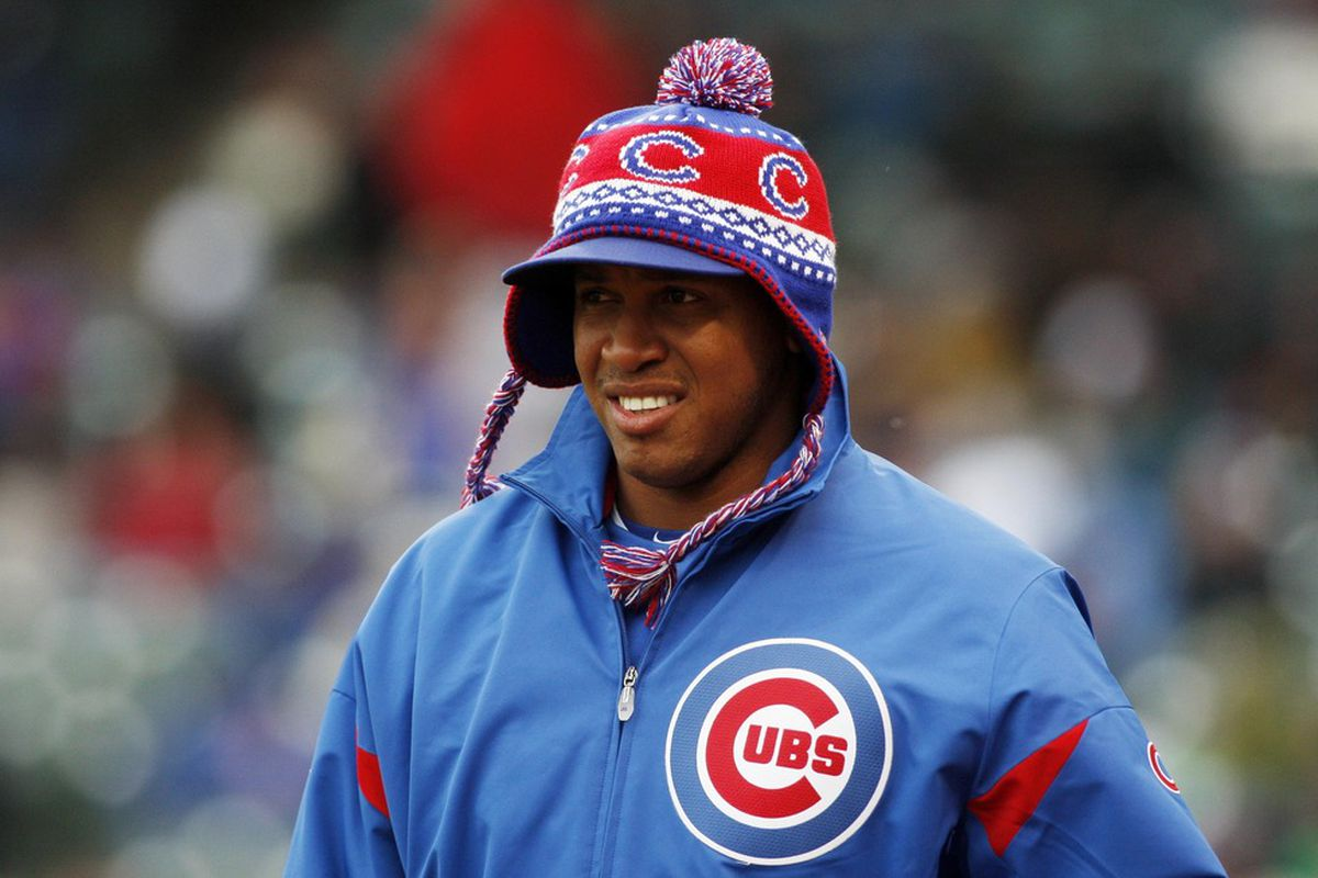 Chicago, IL, USA; Chicago Cubs relief pitcher Carlos Marmol walks out to the bullpen while wearing a winter hat during the seventh inning against the Cincinnati Reds at Wrigley Field.  Credit: Jerry Lai-US PRESSWIRE