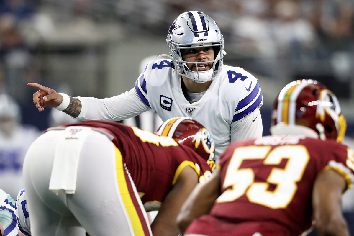 Dak Prescott #4 of the Dallas Cowboys calls out instructions in the first quarter against the Washington Redskins in the game at AT&T Stadium on December 29, 2019 in Arlington, Texas.