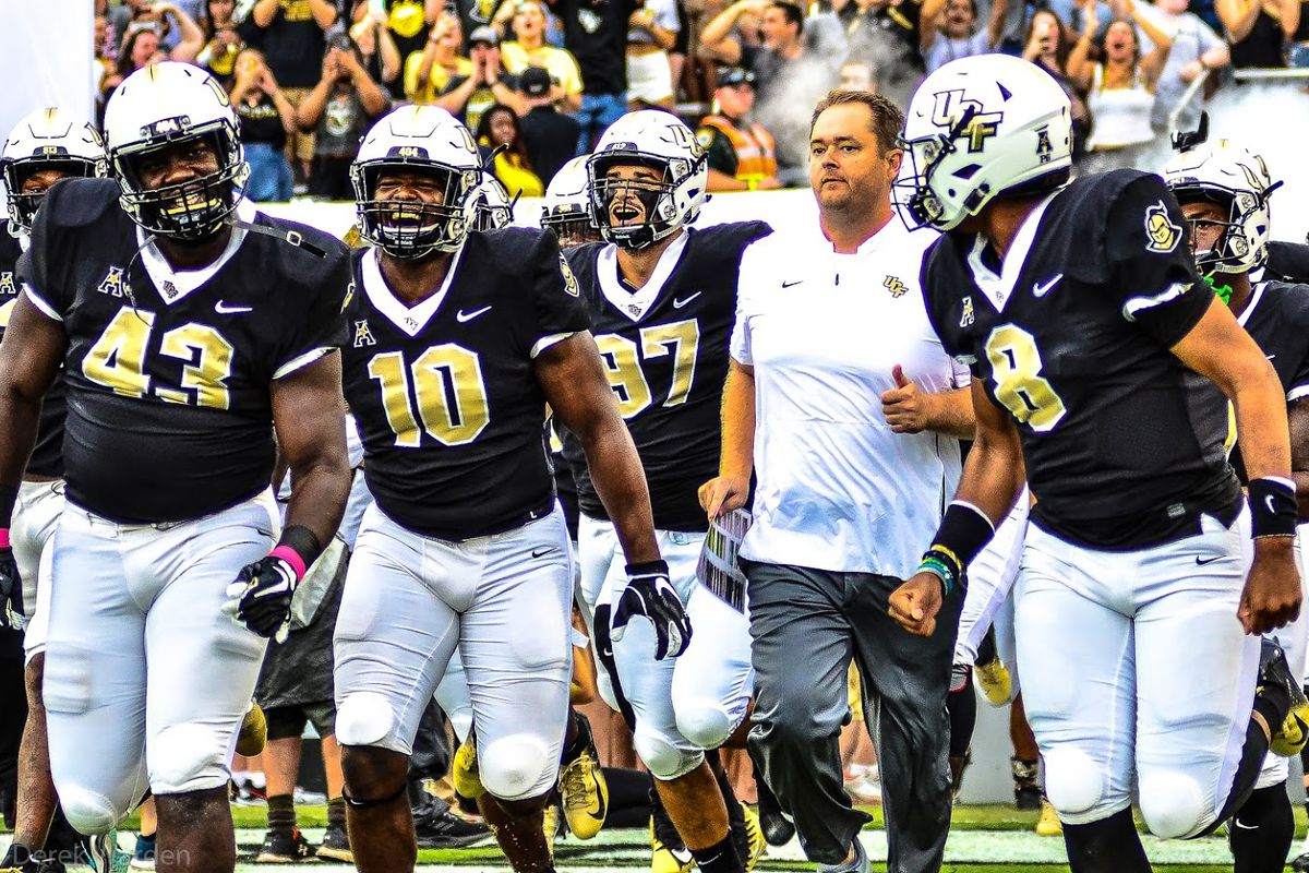 UCF Knights charge on to the field prior to their game against the South Carolina State Bulldogs. (Photo: Derek Warden)