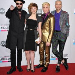 """Members of Neon Trees, from left, Branden Campbell, Elaine Bradley, Chris Allen and Tyler Glenn arrive at the 40th Anniversary American Music Awards on Sunday, Nov. 18, 2012, in Los Angeles. Bradley recently released her own """"I'm a Mormon"""" video."""