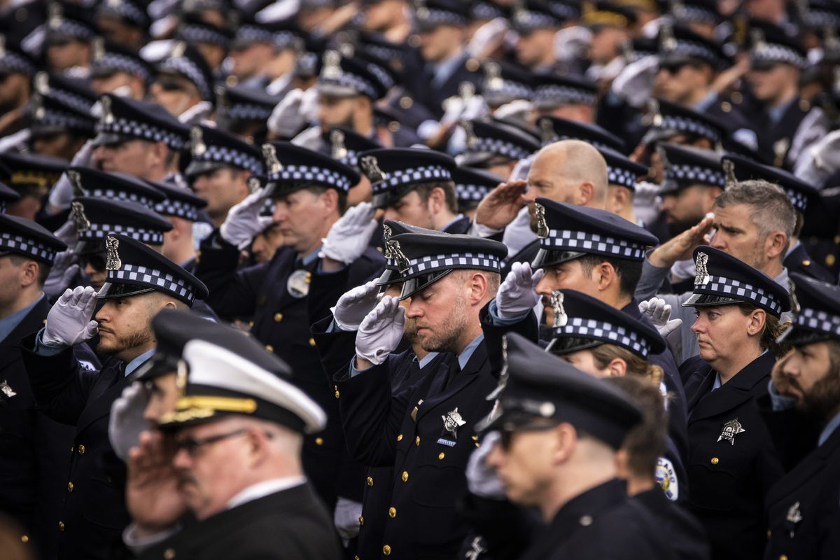 Hundreds of Chicago police officers and other law enforcement officers gather Thursday outside St. Rita of Cascia Shrine Chapel for the funeral of Officer Ella French. French was fatally shot and her partner was critically wounded while in the line of duty on Aug. 7 in West Englewood.