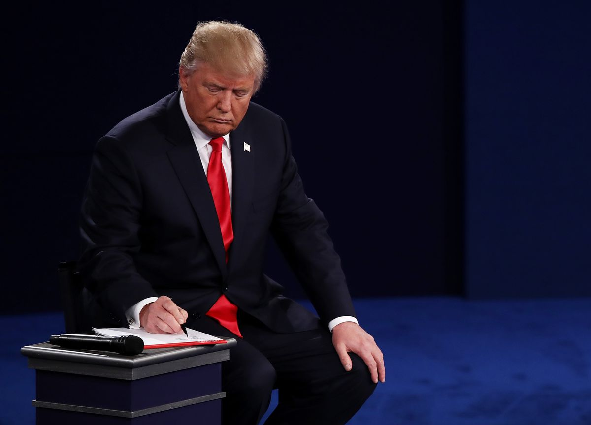 Donald Trump takes notes at the second presidential debate.