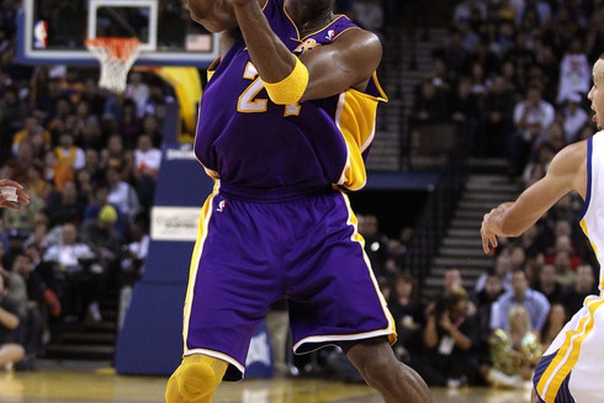 OAKLAND CA - JANUARY 12:  Kobe Bryant #24 of the Los Angeles Lakers passes the ball during their game against the Golden State Warriors at Oracle Arena on January 12 2011 in Oakland California.  (Photo by Ezra Shaw/Getty Images)
