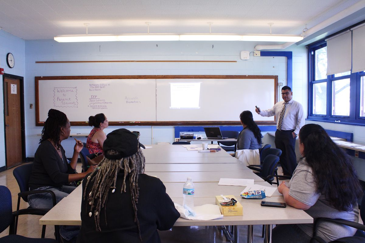 Local school council members at a training session in 2018.