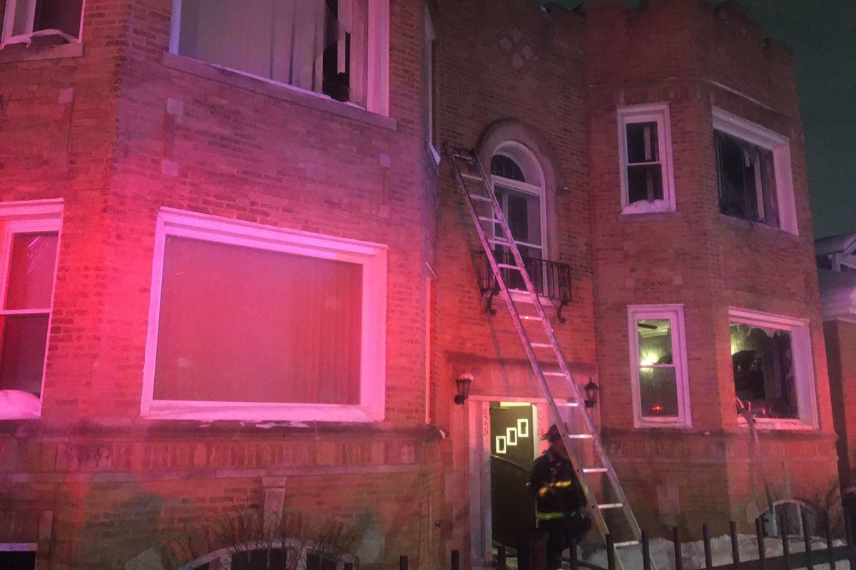 Firefighters respond to the scene of a blaze Feb. 18, 2021, at an apartment in the 9200 block of South Loomis Street.