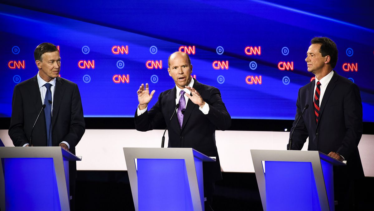 Democratic presidential hopefuls (L-R) Former Governor of Colorado John Hickenlooper, former Representative for Maryland's 6th congressional district John Delaney and Governor of Montana Steve Bullock participate in the first round of the second Democrati