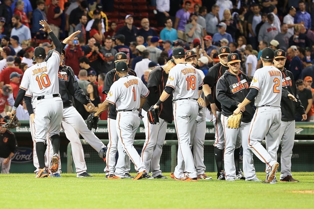 Orioles players celebrate after a 1-0 victory in Boston.