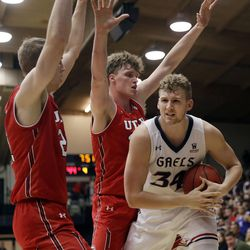 Saint Mary's center Jock Landale, right, is double-teamed by Utah forwards Tyler Rawson, left, and Jayce Johnson during the second half of an NCAA college basketball game in the quarterfinals of the NIT, Wednesday, March 21, 2018, in Moraga, Calif. (AP Photo/Marcio Jose Sanchez)