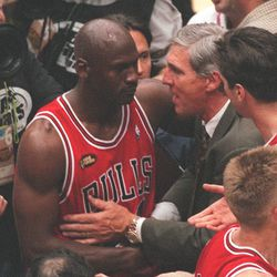 Jazz coach Jerry Sloan congratulates Michael Jordan after the Bulls won their third-straight title in Game 6 of the NBA Finals at the Delta Center, June 14, 1998.